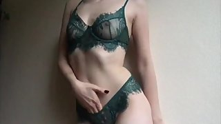 Blonde girl in lingerie canТt help but touch herself
