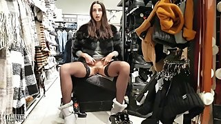 In stockings, without panties and in a public place, she buys new shoes